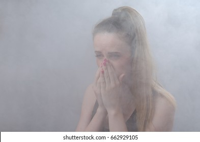 The girl suffocates from thick smoke