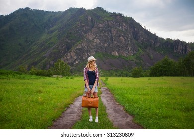 girl with a suitcase on the road
