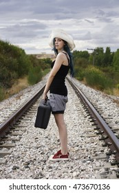 Girl with suitcase ready to travel