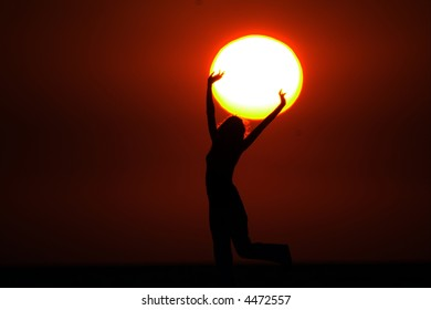 Girl with Sun in the hands on sundown