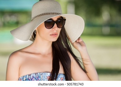 the girl in the sun hat