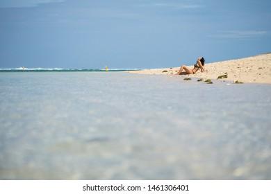 Girl sunbathes on the ocean