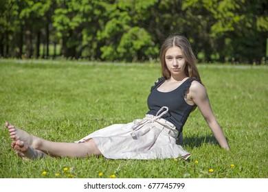 Girl sunbathing on the grass