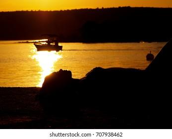 Girl sunbathing in sunset