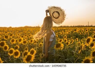 Girl in the sunflower field