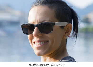 Girl with sunglasses on blurry background