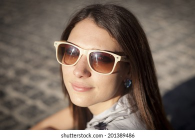 Girl in sunglasses  on the street at the sunset time, bussiness style