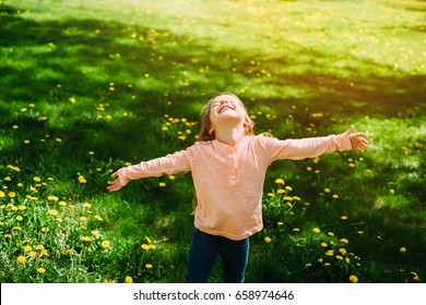 Girl in the sunlight in the field