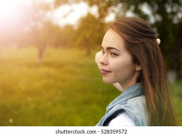 The girl in the sunny morning in a meadow
