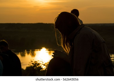 The girl and sunset - Shutterstock ID 562643056