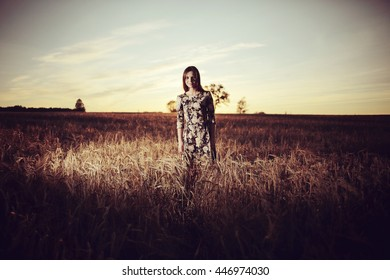 girl sunset in the rustic landscape of wheat