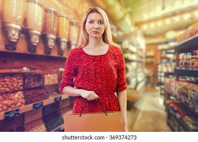Girl in the supermarket. Shopping.