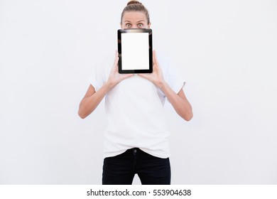 Girl with surprise shows tablet. On a white background.