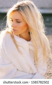Girl in sweater close-up portrait outdoor. Warm fall.