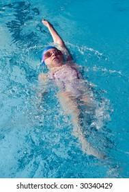 Girl swimming backstroke