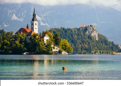 Girl swimming in Bled lake, zoom in