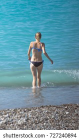 girl in a swimsuit on the beach, part of the body