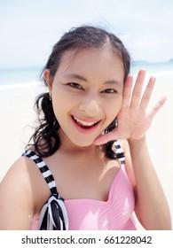 girl in swimsuit selfie acting cute