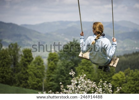Girl swinging ...
