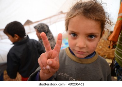 A girl of Syrian refugees sends a message of peace and democracy. Atma camp, Syria, December 19, 2012