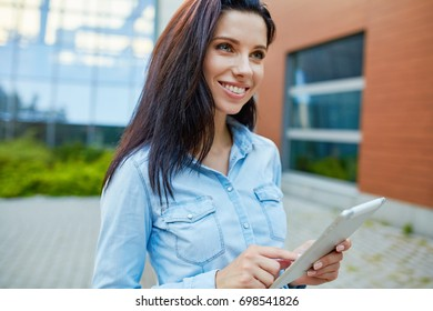 Girl with a tablet outdoor