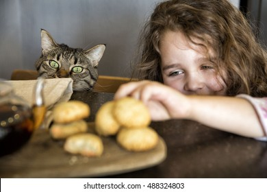 the girl takes cookies