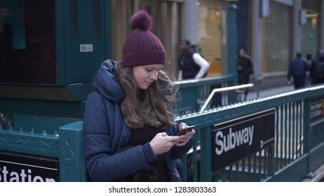 Girl takes a selfie at Manhattan Subway Station - NEW YORK / USA - DECEMBER 4, 2018