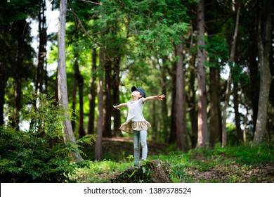 Girl taking deep breath in the woods