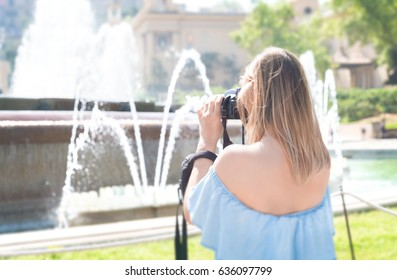 Girl taking a photo.