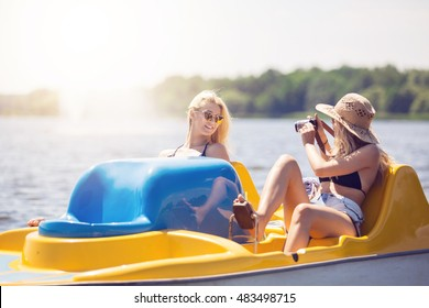 Girl taking a photo of her friend