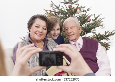 Girl taking photograph of family