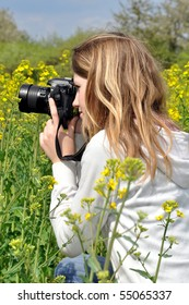 girl taking photos in rapeseed field