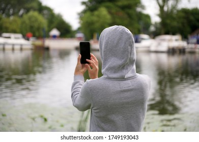 Girl taking a picture with mobile phone
