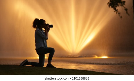 Girl taking pictures in extraordinary landscape full of light and water