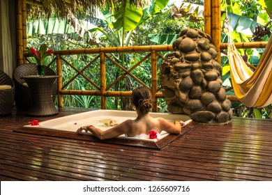 Girl taking a relaxing bath with jungle view