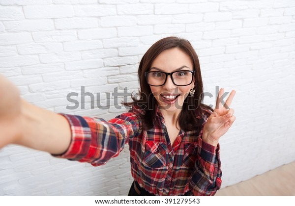 Girl Taking Selfie Smart Phone Photo Camera Woman Posing Over White Brick Office Wall