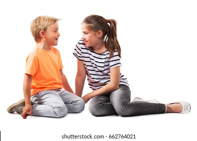 GIRL TALKING TO BOY, KID SPEAKING AND LISTENING TO EACH OTHER ISOLATED OVER WHITE BACKGROUND