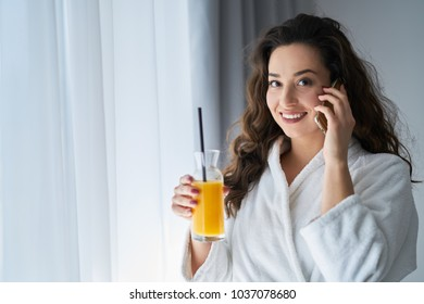 Girl talking on the phone in the hotel room