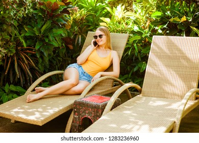girl talking on the phone on the sunbed