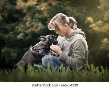 The girl talks to the dog. Nature, green grass, beautiful