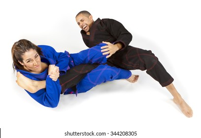 Girl tapping man out with jiu jitsu grappling submission