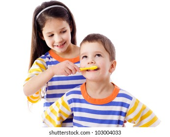 Girl teaches a boy to brush your teeth, isolated on white