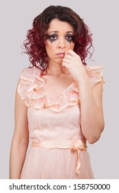 A girl in tears. Facial emotions of a young woman in vintage dress
