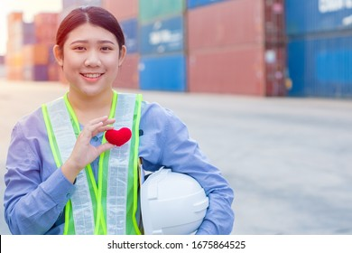 Girl teen worker in cargo container shipping port working with heart and good service mind concept.