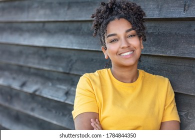 Girl teenager teen female young African American mixed race biracial woman outside smiling with perfect teeth
