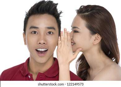 Girl telling secrets to her friend
