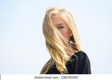 Girl tender blonde makeup face sky background. Bleaching roots. How to repair bleached hair fast and safely. How to take care of bleached hair. Hairdresser tips concept. Salvaged my bleached hair.