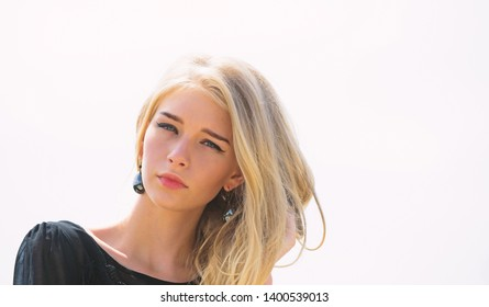 Girl tender blonde makeup face sky background. How to repair bleached hair fast and safely. Bleaching roots. Hairdresser tips concept. Salvaged my bleached hair. How to take care of bleached hair.