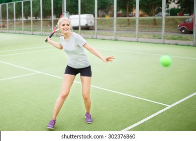 Girl tennis player on the court with a racket. Athletic, health, sports, lifestyle.