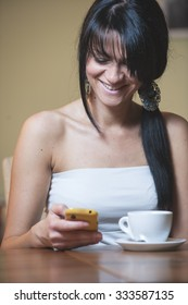 girl texting and drinking coffee